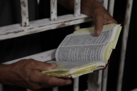 Inmate-Prisoner-Reading-Holy-Bible-in-Jail-Prison-Penitentiary-Wide-Pic[1]
